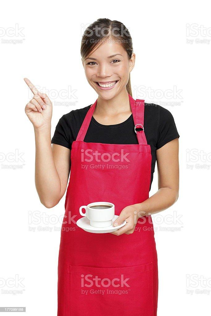 Waitress pointing holding coffee stock photo