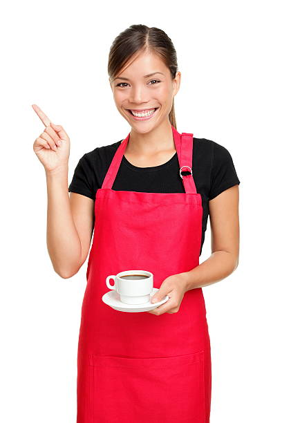 Waitress pointing holding coffee stock photo