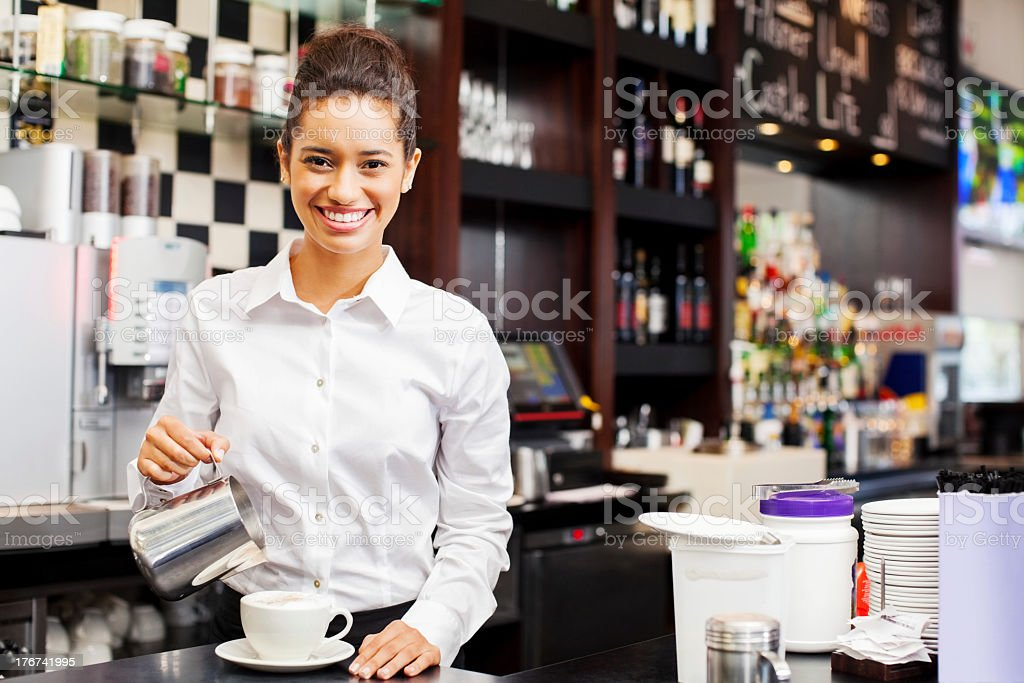 Waitress Pouring Coffee In Cup At Restaurant Counter royalty-free stock photo