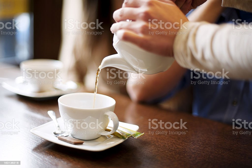 Waitress pouring cup of coffee/tea stock photo