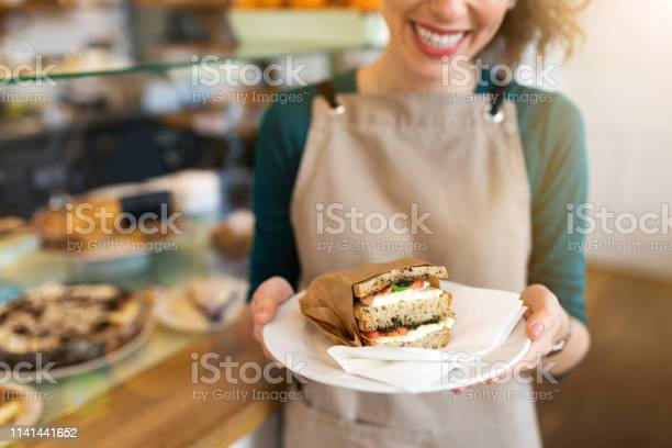 Waitress ready to serve food in cafe picture id1141441652?b=1&k=6&m=1141441652&s=612x612&h=loo1nqxzv67xbm9rcichgh3ne1jlnyspmfqsssizjui=