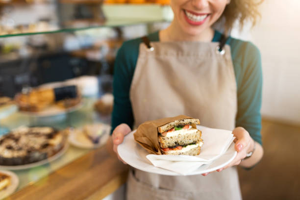 Waitress ready to serve food in cafe Waitress ready to serve food in cafe female sandwich stock pictures, royalty-free photos & images