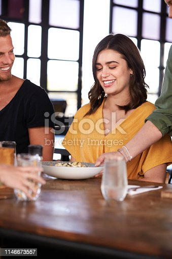 635812444 istock photo Waitress Serving Couple Meeting For Drinks And Food In Restaurant 1146673557