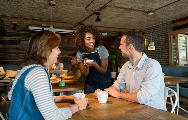 waitress serving customers at a restaurant - being in a relationship with someone is going to require stock photos and pictures