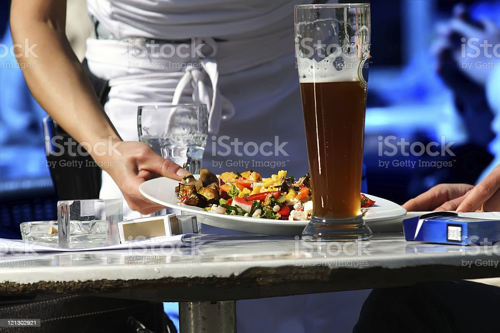Waitress serving food royalty-free stock photo