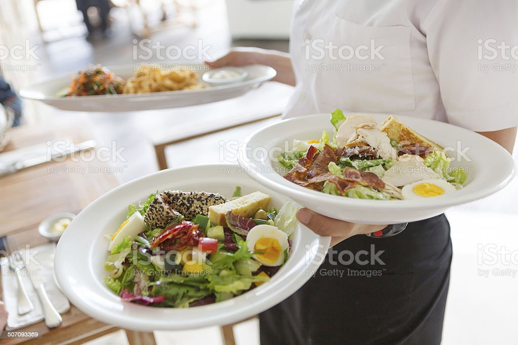 Waitress serving food stock photo