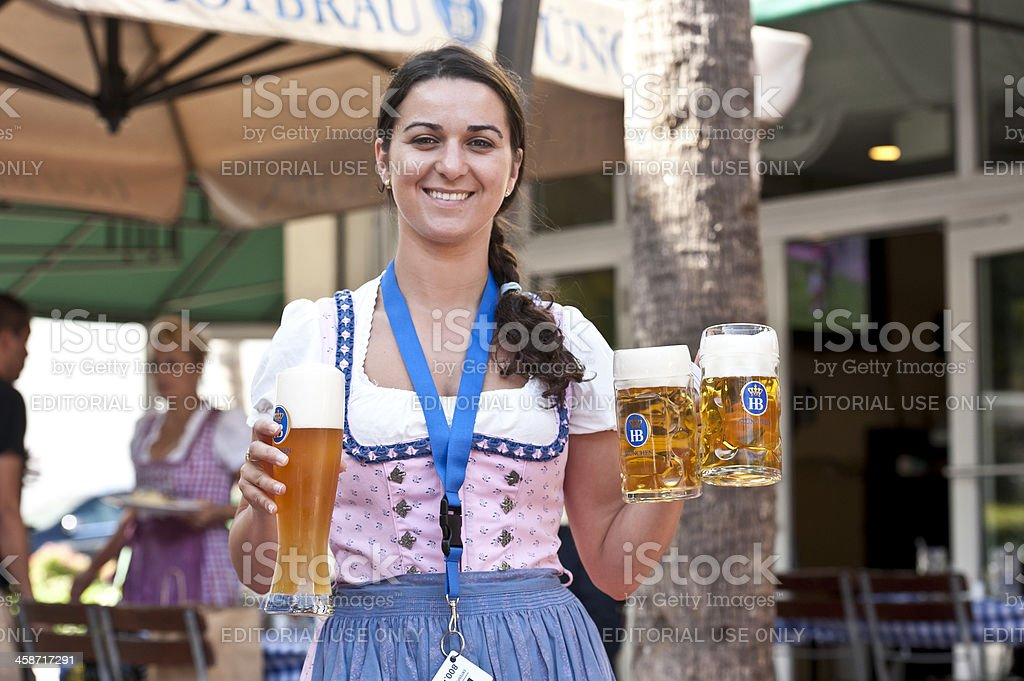 Waitress Serving German Beer royalty-free stock photo