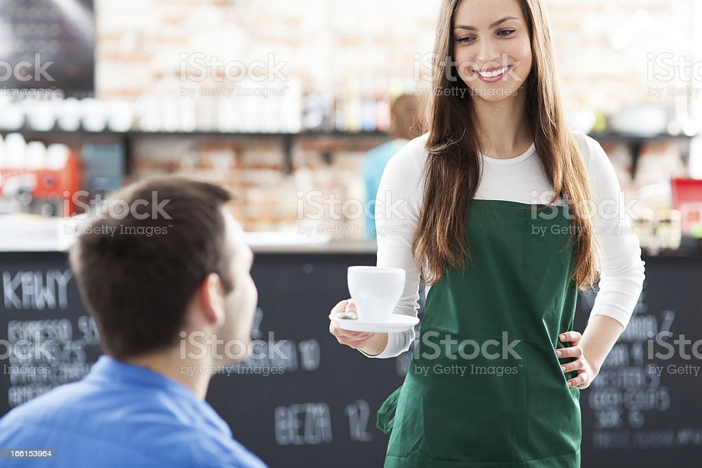 Waitress serving man coffee royalty-free stock photo