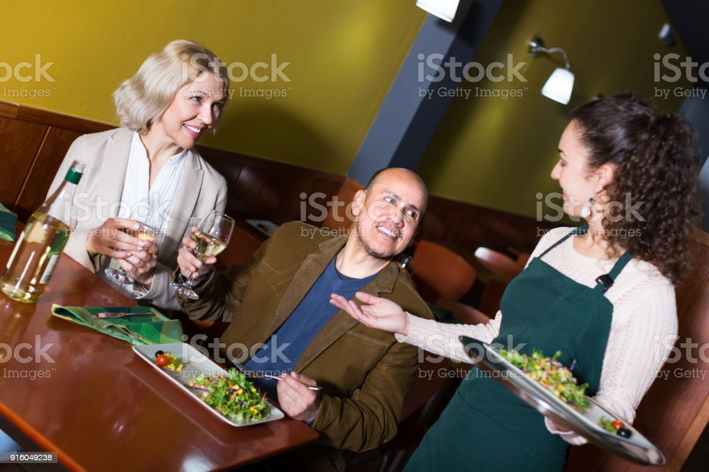 Waitress Serving Senior Customers Stock Photo - Download