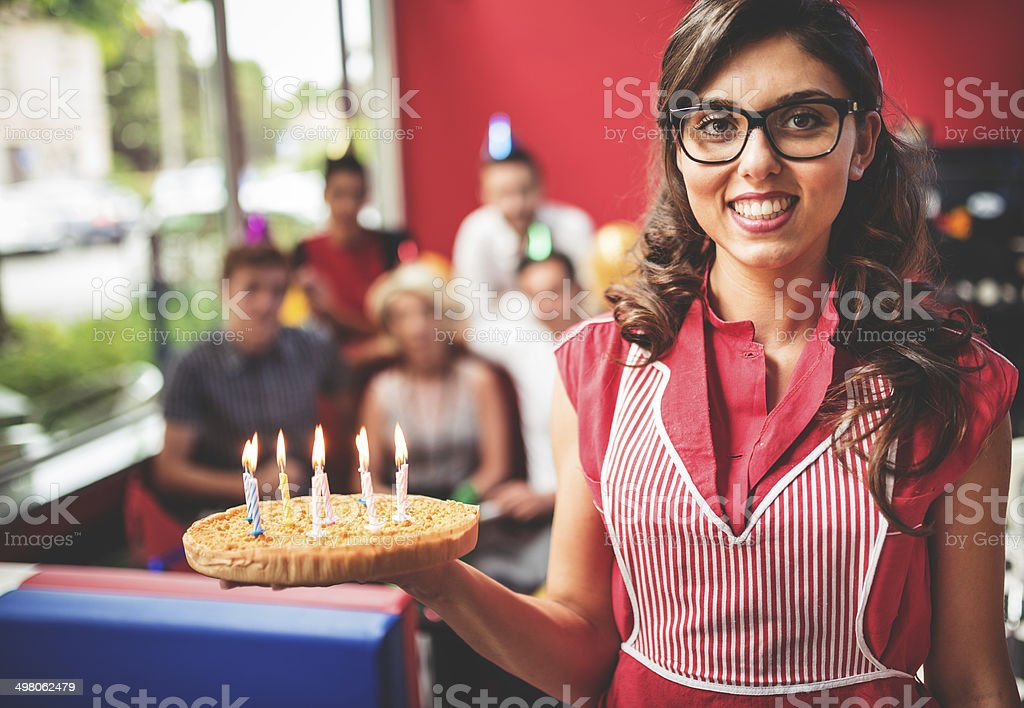 waitress serving the cake at the birthday party stock photo