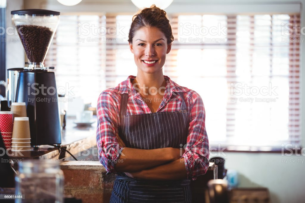 Waitress standing with arms crossed royalty-free stock photo