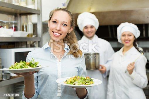 istock Waitress taking dish from kitchen 626501238