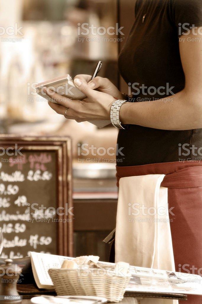 Waitress taking order stock photo