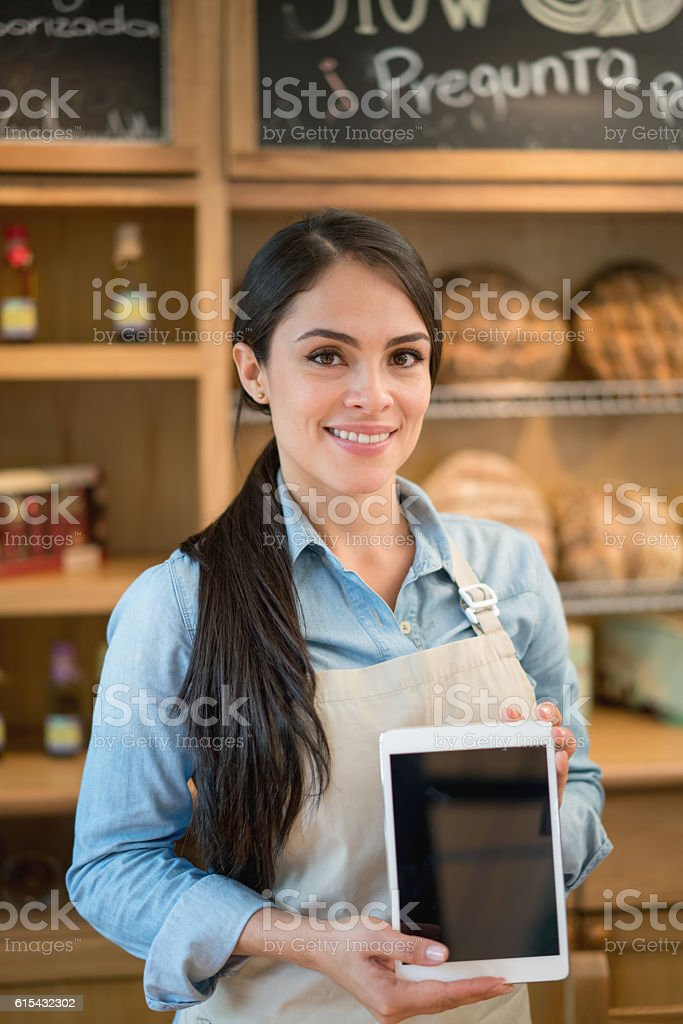 Waitress using a tablet computer stock photo