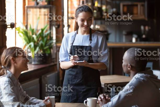 Waitress welcoming restaurant guests take order writing on notepad picture id1172964157?b=1&k=6&m=1172964157&s=612x612&h=eoppttinvyidvwkkafe6s5 ookadgbky3eaiyj8alts=