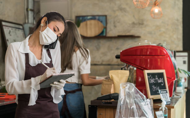 Waitress with face mask take order for curbside pick up and takeout. stock photo
