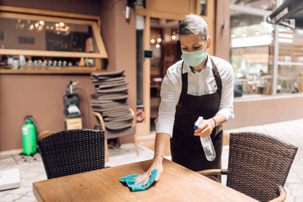 Waitress working at the reopened restaurant during Covid-19 pandemic stock photo
