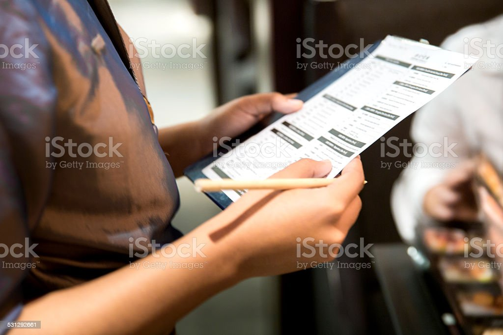 Waitress writing a food order stock photo