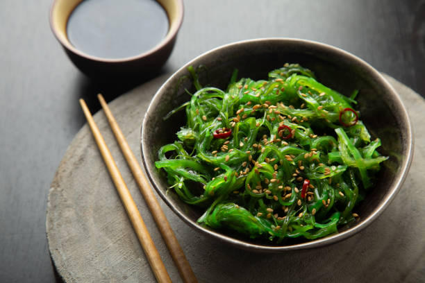 Wakame salad with sesame and chili pepper stock photo