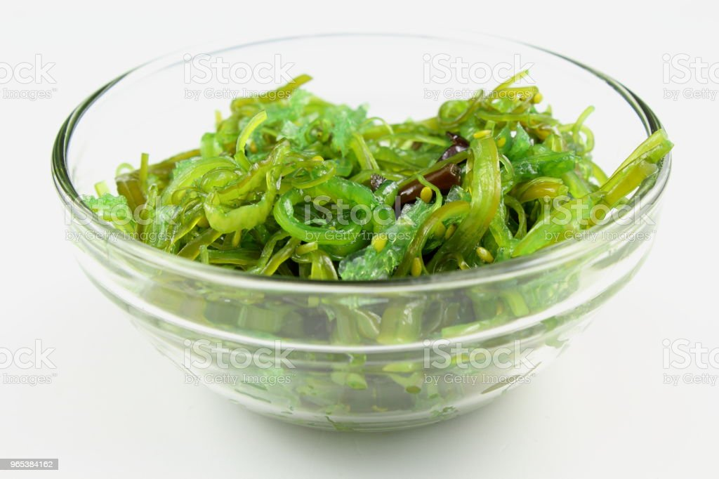 wakame salad with sesame in a small glass bowl isolated zbiór zdjęć royalty-free