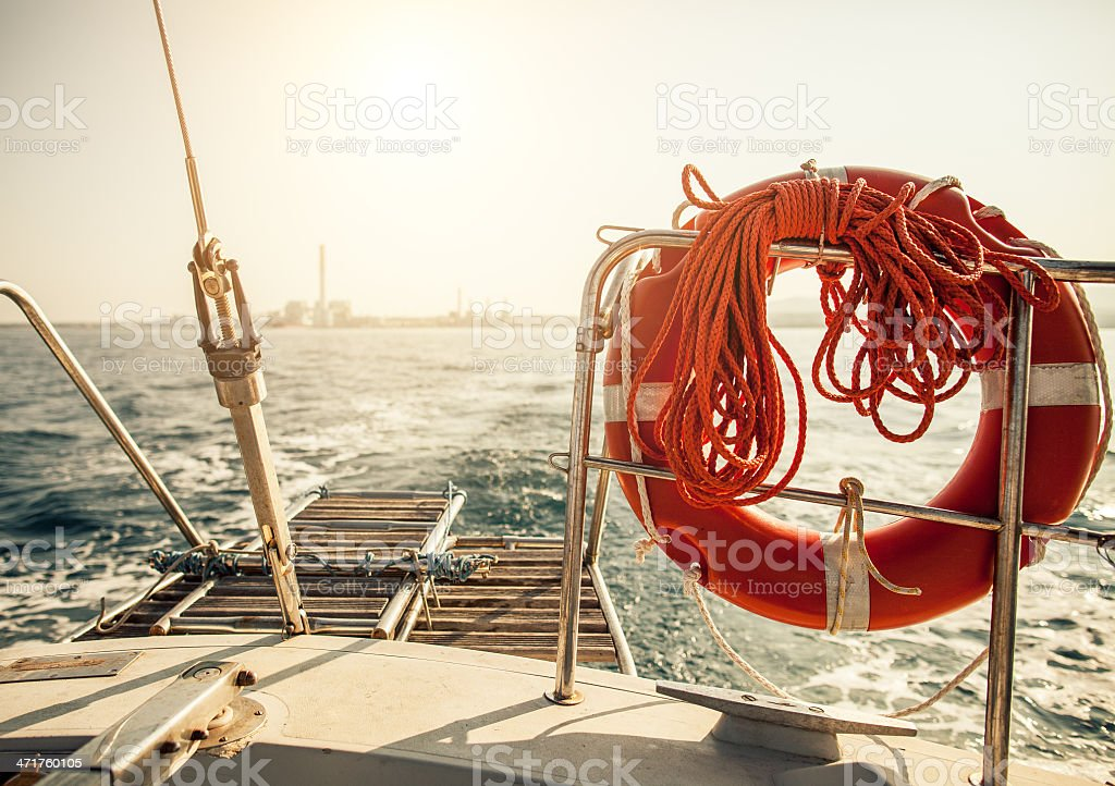 Wake of a Sailing Boat leaving the coast royalty-free stock photo