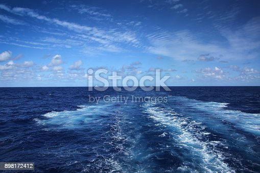 Wake of a ship across the Atlantic Ocean, on a beautiful day.