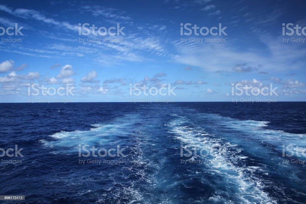Wake of a ship across the Atlantic Ocean, on a beautiful day. stock photo