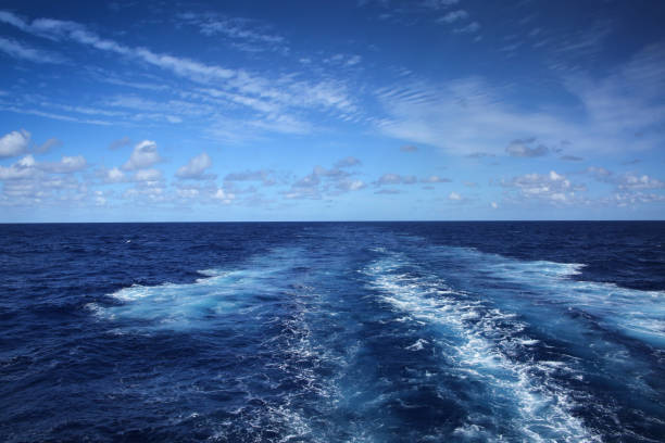 wake of a ship across the atlantic ocean, on a beautiful day. - atlantic ocean stock pictures, royalty-free photos & images