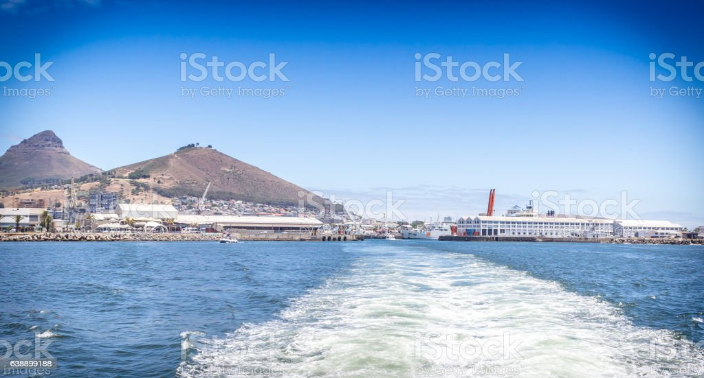 Wake of boat leaving harbour at Victoria & Alfred Waterfront, stock photo