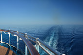 Wake of the cruise ship at see seen from open deck.