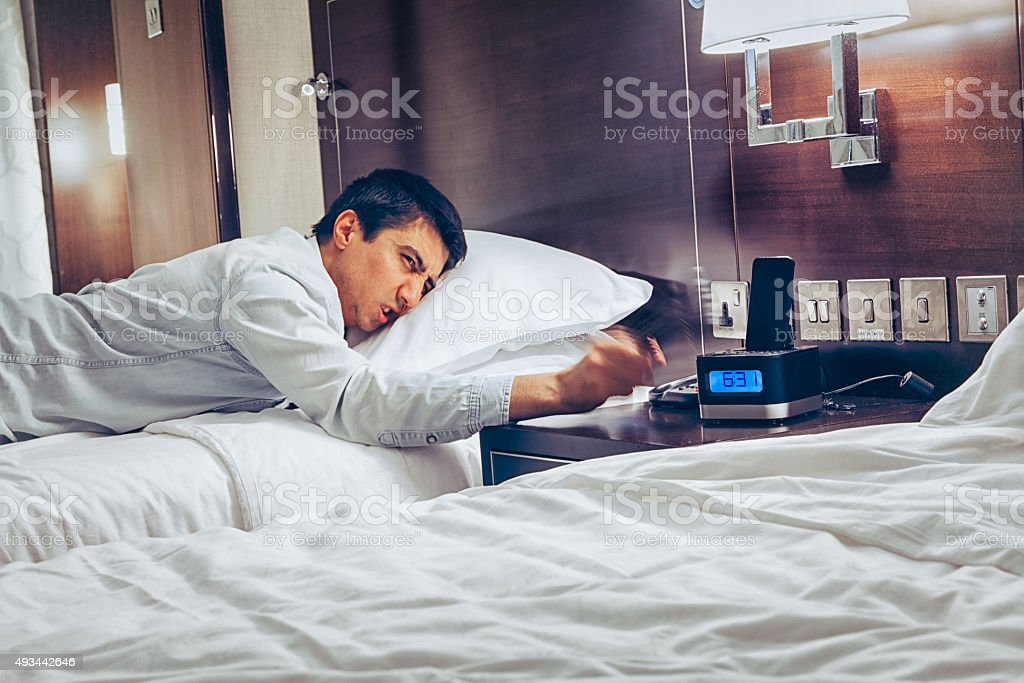 Wake Up Early Time - Angry sleepless man stock photo