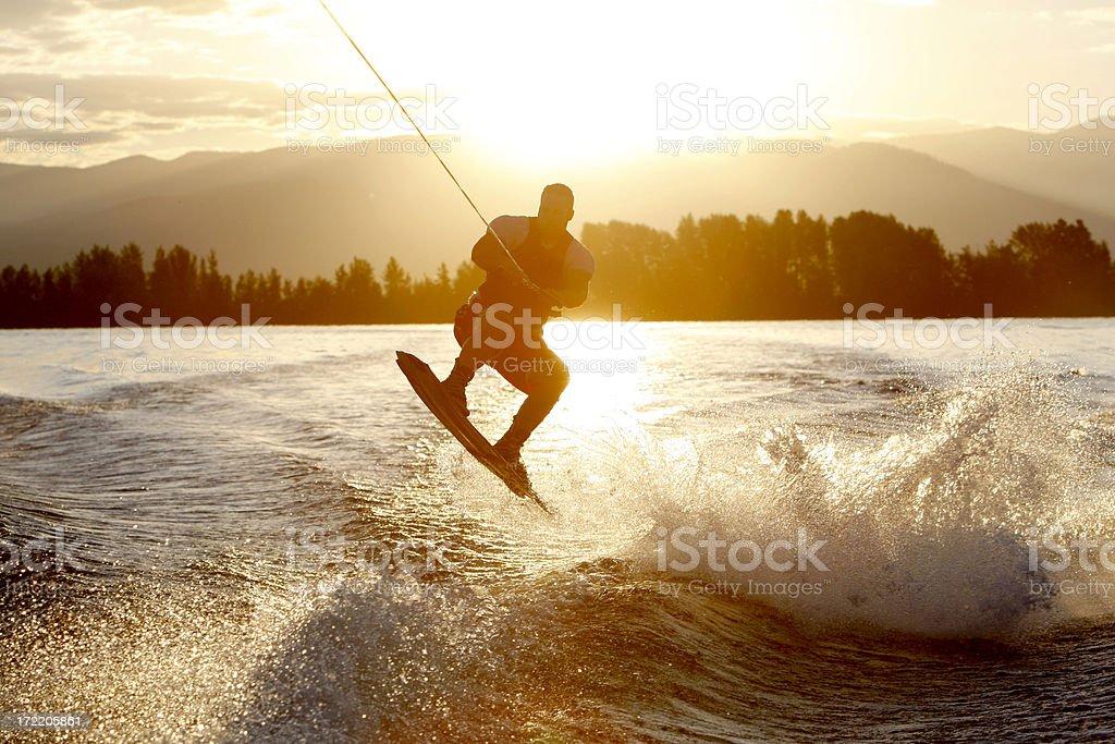 wakeboarder at sunrise stock photo