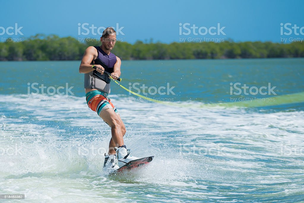 Wakeboarder behing a boat stock photo