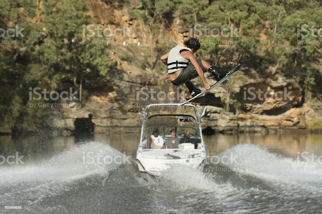 Wakeboarder in air, shot from behind stock photo