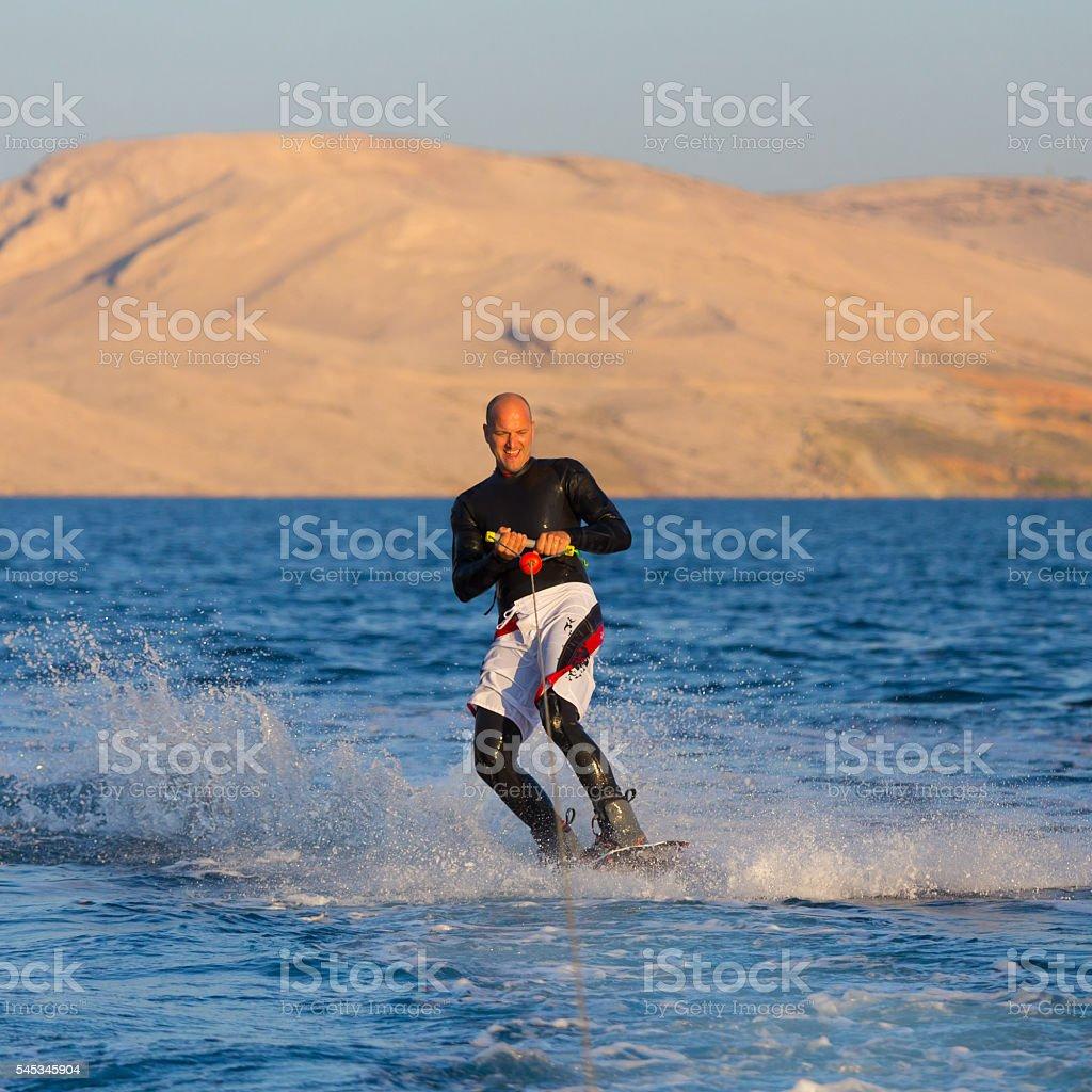 Wakeboarder im Sonnenuntergang. Lizenzfreies stock-foto