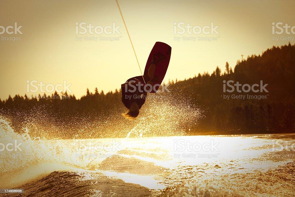 Wakeboarder inverted at sunrise stock photo