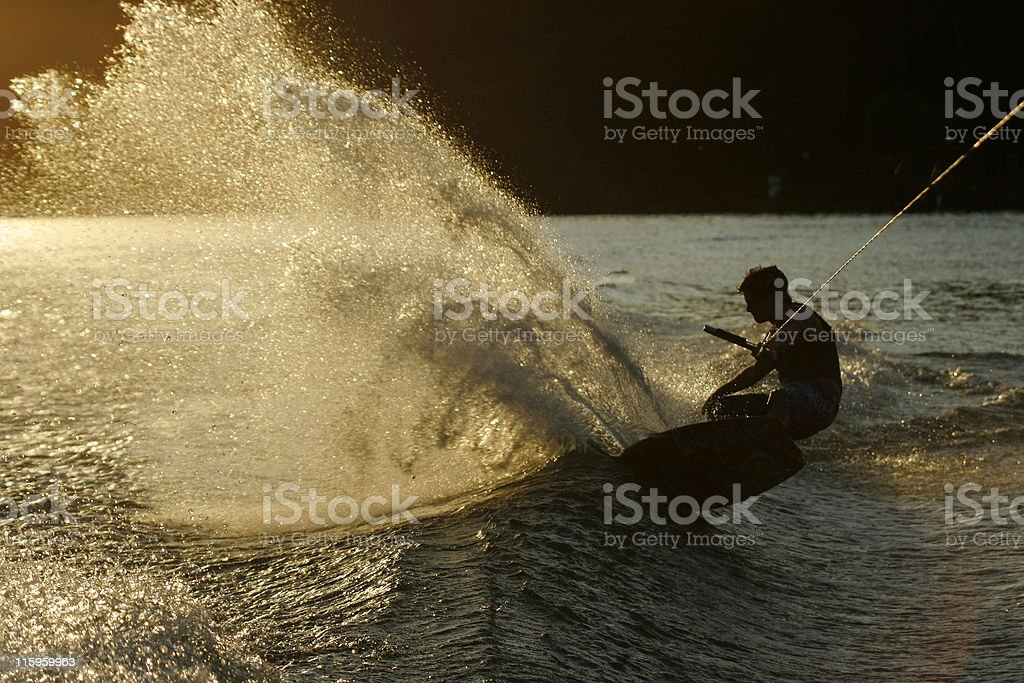 Wakeboarder slashing wake / wave royalty-free stock photo