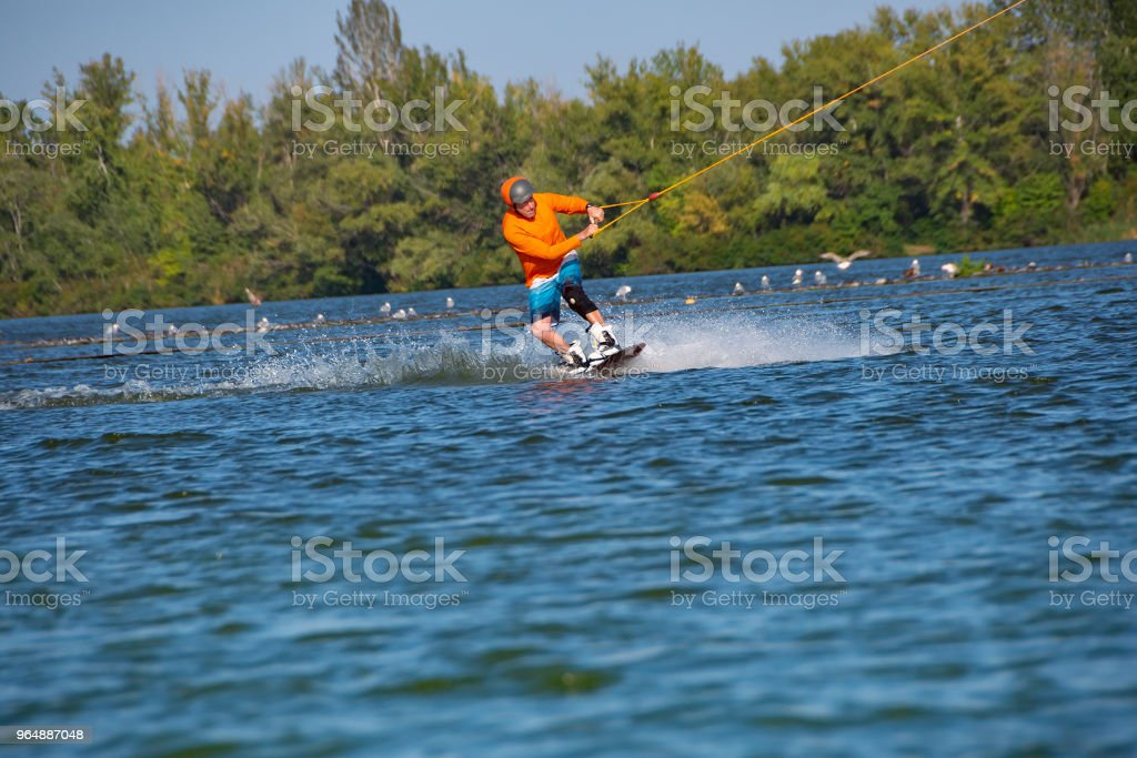 Wakeboarder trains in a cable park royalty-free stock photo