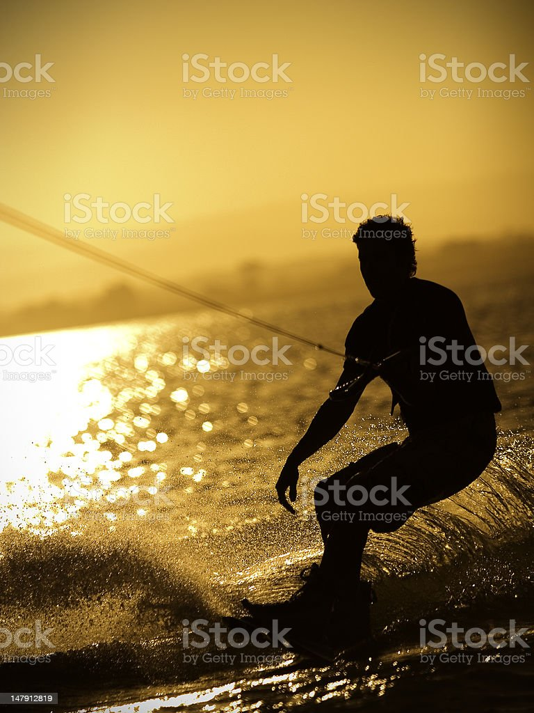 Wakeboarding at sunset royalty-free stock photo