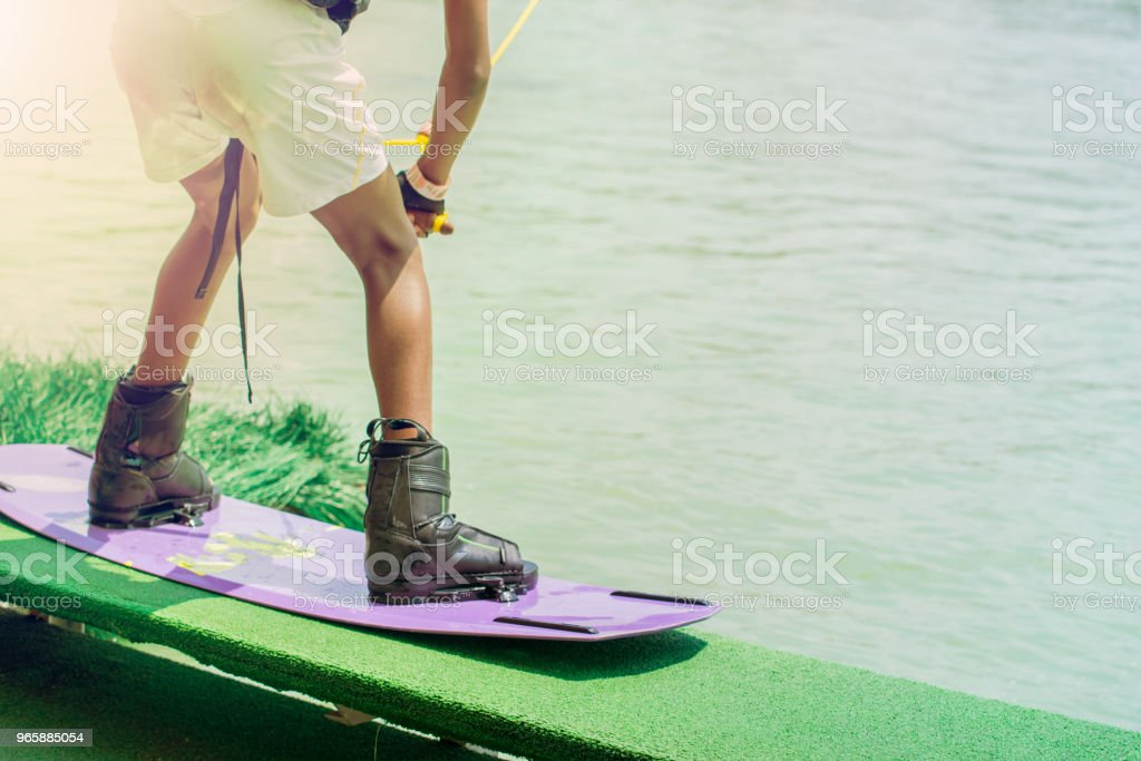 wakeboarding at the wake park. Outdoor and extreme sport. - Royalty-free Activity Stock Photo
