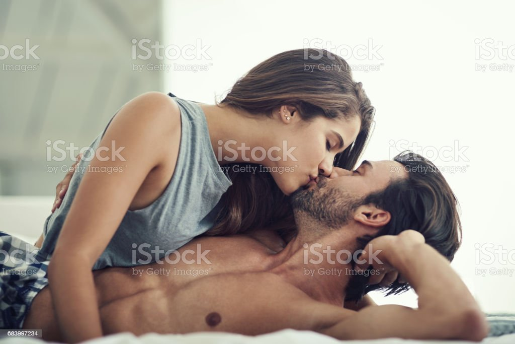 Waking him up with loving kisses stock photo