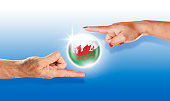 Wales button welsh flag floating between human hands