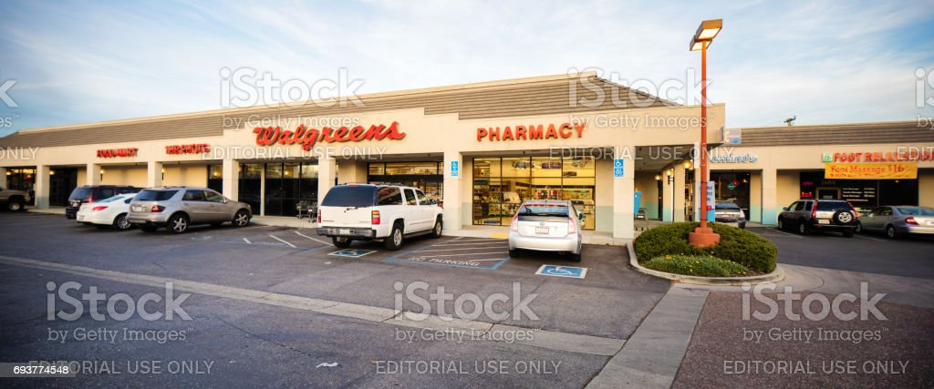 Walgreens pharmacy drug store entrance facade with sign panorama,...