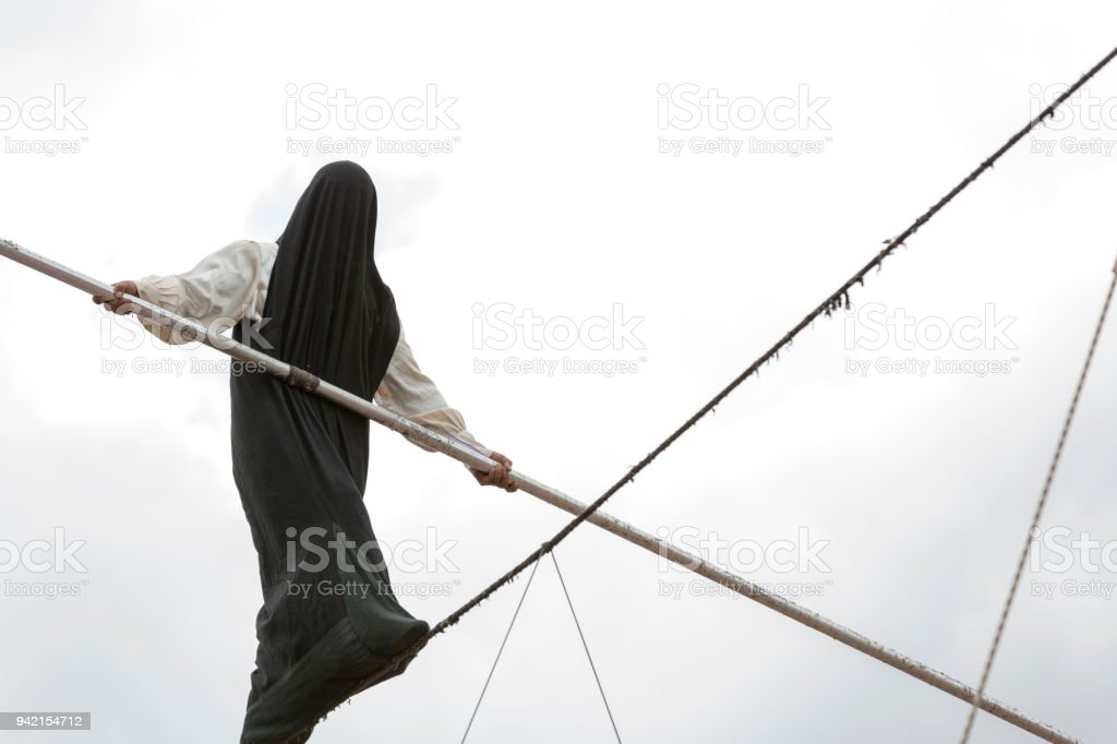 Walk a line in the sky. stock photo