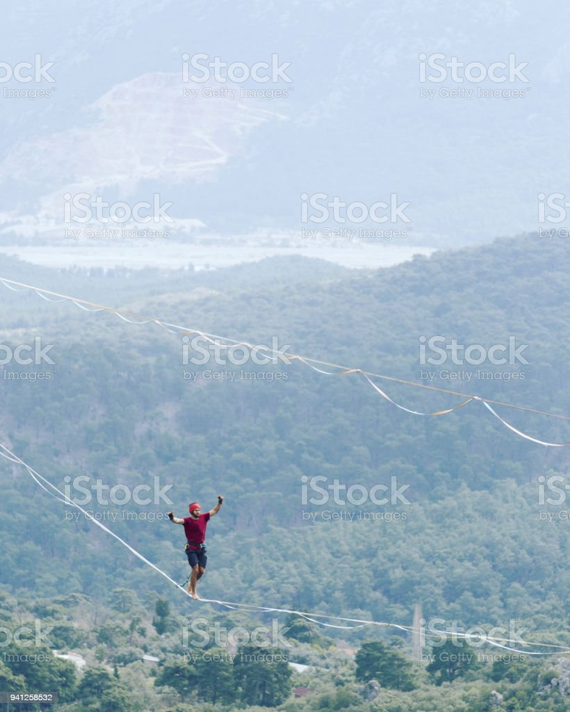 Walk a line in the sky.Turkish Highline Carnival in Antalya. stock photo