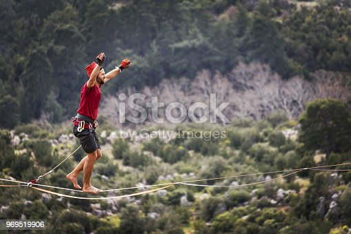 istock Walk a line in the sky.Turkish Highline Carnival in Antalya. 969519906