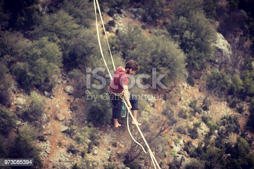 istock Walk a line in the sky.Turkish Highline Carnival in Antalya. 973085394