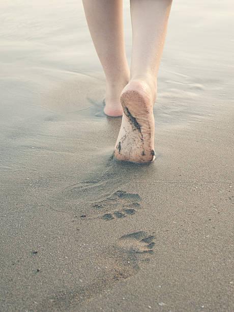 Walk along the beach stock photo