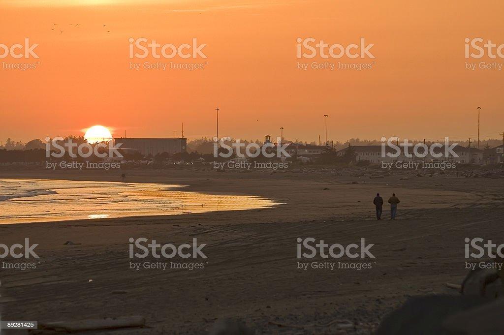 Walk at sunset on the beach stock photo