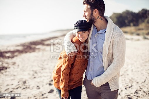 Close up of a young couple enjoying time on the beach